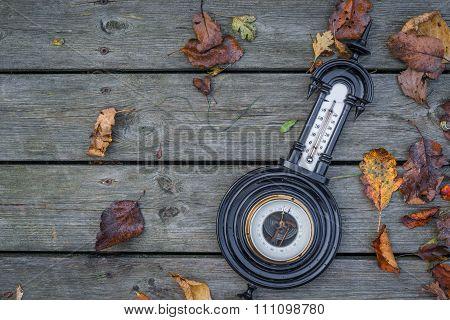 Antique Barometer On Wooden Background