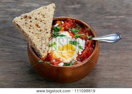 Fresh Eggs Poached In Tomato Sauce And Onion, Red, Yellow Pepper Served With Bread.