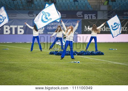 A Cheerleading Flash Mob Dance Troupe Peform