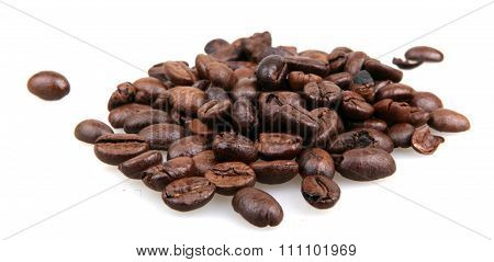 roasted coffee beans isolated in white background