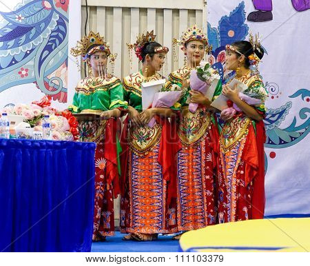 JAKARTA, INDONESIA - NOVEMBER 16, 2015: Ladies dressed in traditional Indonesian costumes prepare for the medals award ceremony at the 13th World Wushu Championship 2015 held in Istora Senayan Stadium
