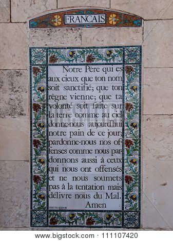 Jerusalem, Israel - July 13, 2015: The Text Of The Prayer Pater Noster In French On One Of The Walls