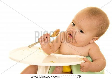 Baby In Seat With Footd On Spoon