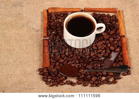 Coffee Beans Cup Of Fragrant Drink And Cinnamon Bars