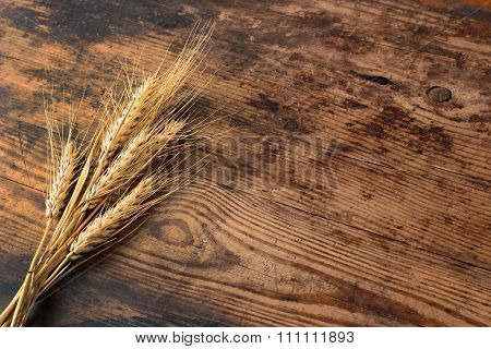 Ears Of Wheat On Wooden Table
