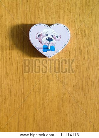 heart shaped hanger with dog image on wooden wall
