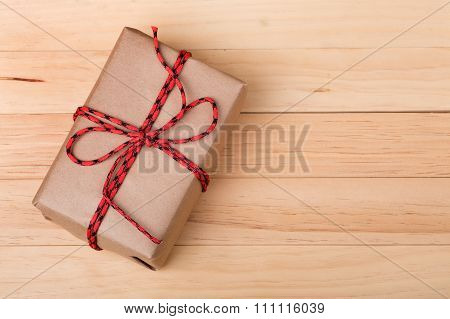 Brown Package On Wood Background