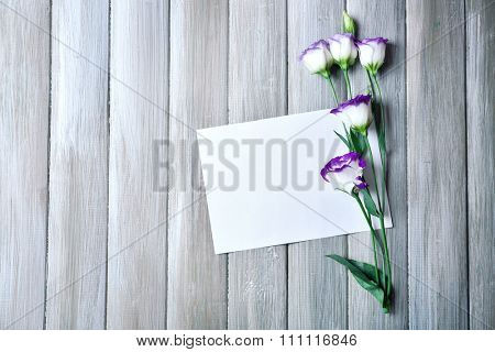 Composition of white sheet and  blossom on grey wooden background, empty space