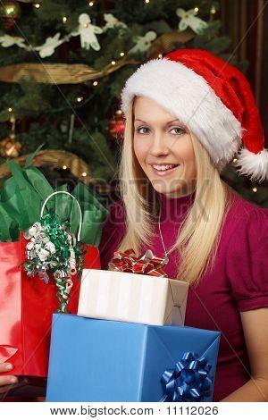 Blond Female Holding Christmas Presents