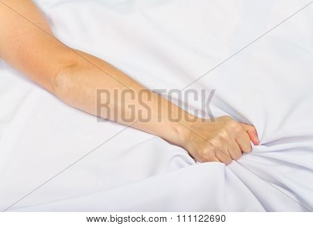 Female Hand Pulling White Sheets In Ecstasy