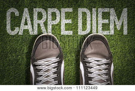 Top View of Sneakers on the grass with the text: Carpe Diem