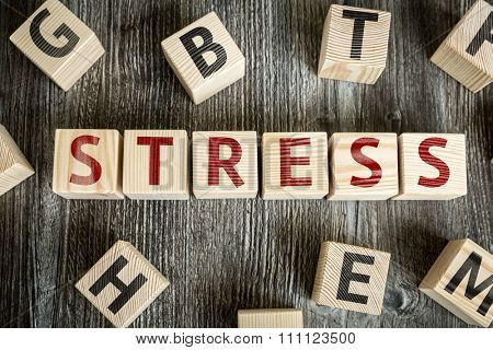 Wooden Blocks with the text: Stress