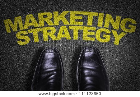 Top View of Business Shoes on the floor with the text: Marketing Strategy