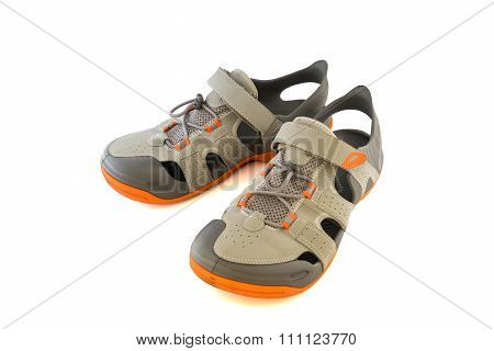Pair Of Used Sport Sandals Over White Background
