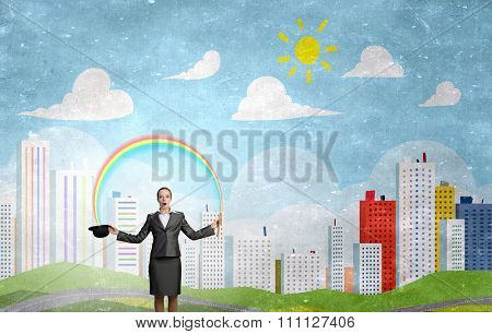 Attractive businesswoman with flute and bowler hat in hand