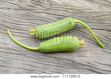 green Sponge Gourd on wooden floor