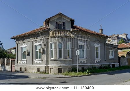 Razgrad town, street and house. Old corner house with balcony