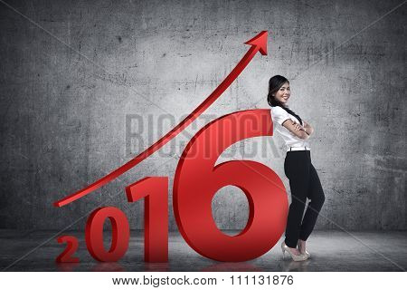 Asian Business Person Lean Next To 2016 Number