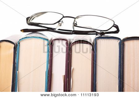 Row of Books and Glasses