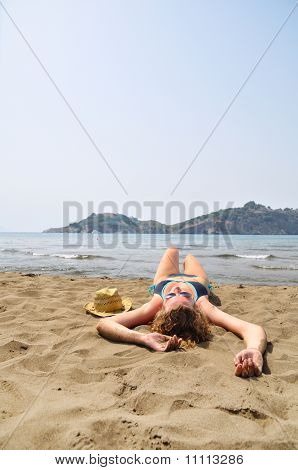 Sexy Woman Is Lying On The Beach