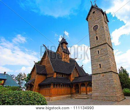 Old wooden Vang stave church with tower of stone in the Karpacz, Karkonosze mountains, Poland