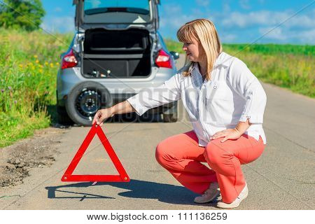 Female 50 Years, Sets On The Road Warning Triangle