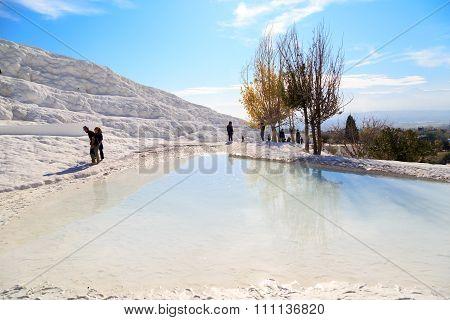 People Walking On Travertine Pools