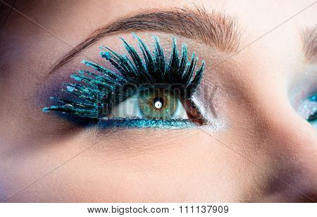 Wintry Creative Eye Makeup. False Long Blue Eyelashes Closeup