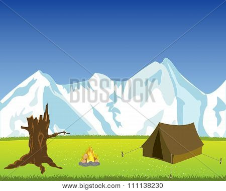 Beautiful landscape of the snow mountains and glade with tent