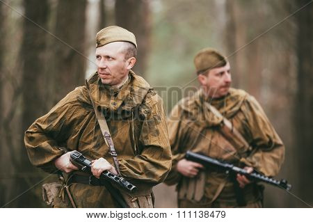 Two unidentified re-enactors dressed as Russian Soviet soldiers