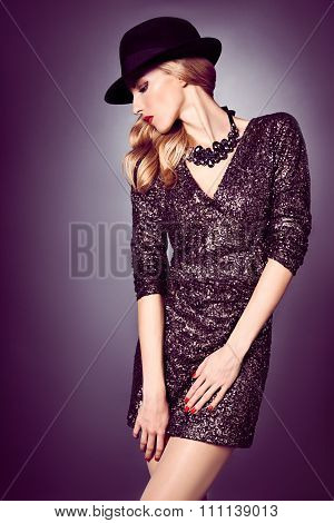 Fashion portrait woman,sequins dress and black hat