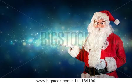 Santa Claus Showing With Hand Something Magical