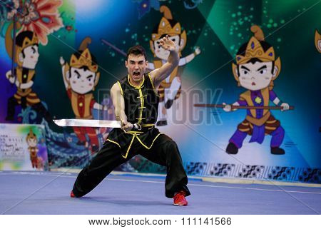 JAKARTA, INDONESIA - NOVEMBER 16, 2015: Mario Martinez of Spain performs the movements in the Men's Nandao event at the 13th World Wushu Championship 2015 at the Istora Senayan Stadium, Jakarta.