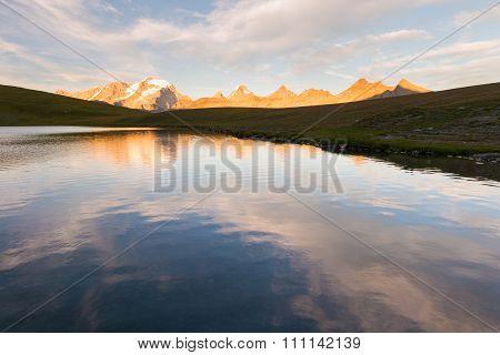 High Altitude Alpine Lake, Gran Paradiso Mountain Range At Sunset