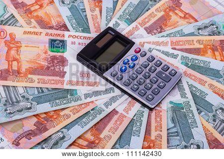 Calculator is on money background