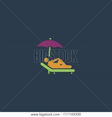 relax under an umbrella on a lounger