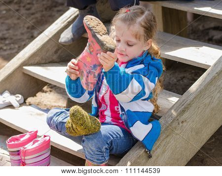 Girl Wears Boots Sitting On The Porch In The Village