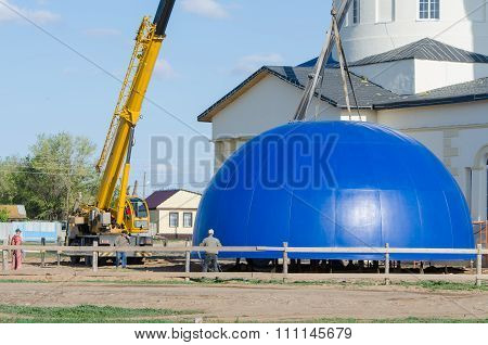 Workers Prepare To Install The Dome On The Roof Of His Reconstructed Church Of The Kazan Mother Of G