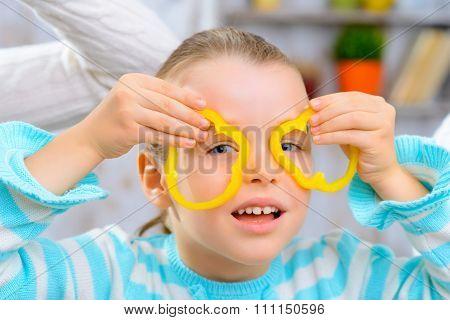 Cheerful girl having fun in the kitchen