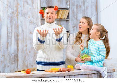 Cheerful family having fun in the kitchen