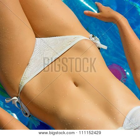 Woman In Swimming Pool. Vacation Concept.