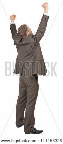 Businessman in winner posture on white