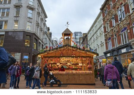 BIRMINGHAM, UK - DECEMBER 03: A sweets stall in busy New Street. The stall was part of the Christmas market taking place along the street. December 03, 2015 in Birmingham.
