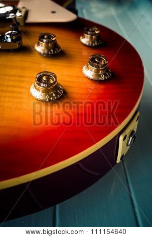 Still life with electric guitar on white wooden background