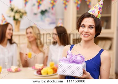 Happy young girl posing with birthday gift