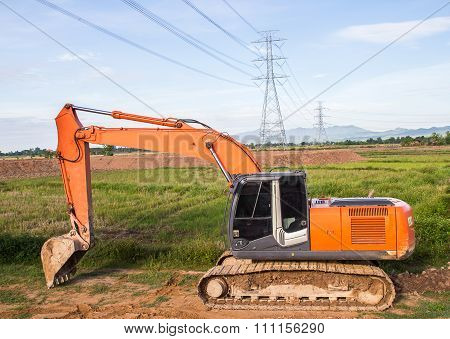 Excavator Orange Machinery, In The Construction Site