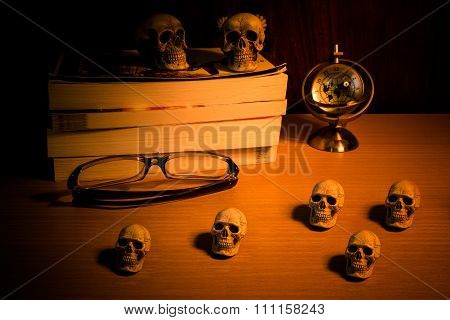 Still life with group of human skull and time to read a book