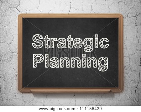 Business concept: Strategic Planning on chalkboard background