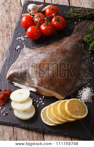 Raw Flounder With Ingredients On A Slate Board Closeup. Vertical
