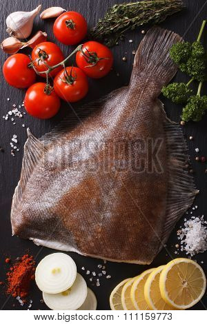 Raw Flounder With Ingredients On A Slate Board Closeup. Vertical Top View